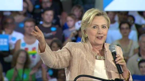 Clinton slams Trump's taxes, campaign staff