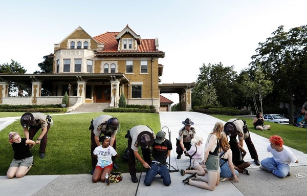 More protesters were arrested Tuesday night near the governor's residence on Summit Avenue in St Paul.