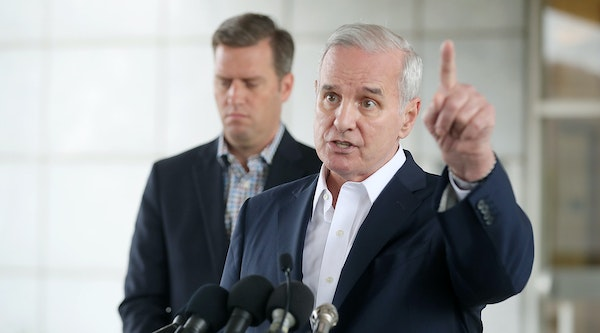 Gov. Mark Dayton and House Speaker Kurt Daudt in August. The governor and House GOP leaders reignited old feuds Wednesday over transportation spending