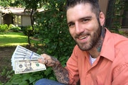 Anthony Darst holds the six realistic-looking but definitely phony bank notes that a thief gave him in June.