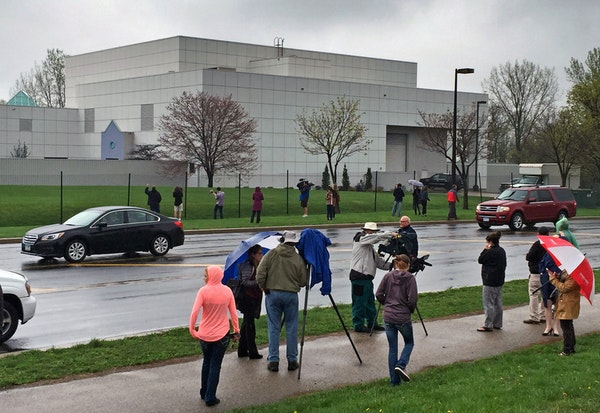 FILE - In this April 21, 2016 file photo, people stand outside entertainer Prince's Paisley Park compound in Chanhassen, Minn.