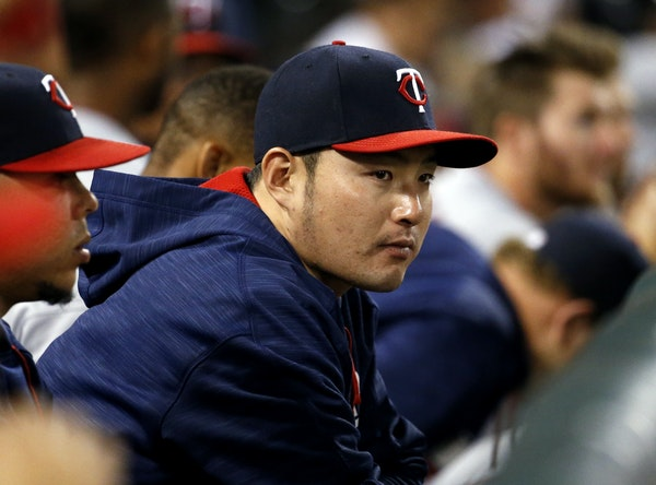 Minnesota Twins' Byung Ho Park, of South Korea, watches teammates during the eighth inning of a baseball game against the Chicago White Sox in Chicago