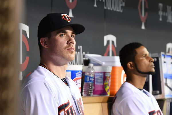 Minnesota Twins relief pitcher Trevor May (65) and Minnesota Twins starting pitcher Ervin Santana (54) looked on after they were both pulled from the
