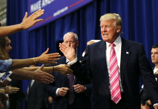 Donald Trump high-fived supporters in the crowd as he arrived at a campaign rally in Fredericksburg, Va., on Saturday.