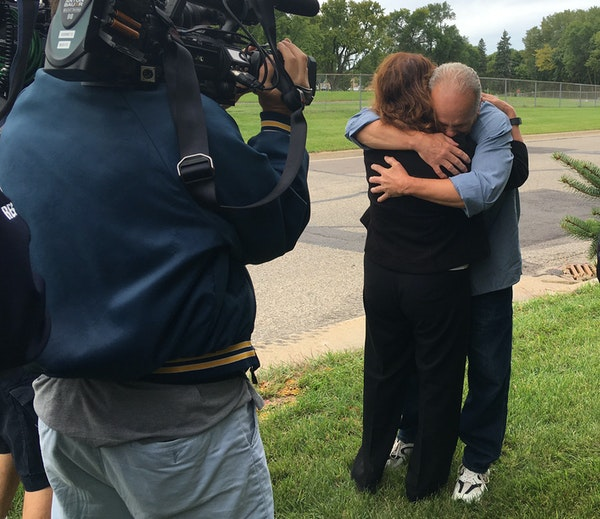 Terry Lynn Olson hugged Julie Jonas, of the Innocence Project of Minnesota, after he was released from prison on Tuesday.