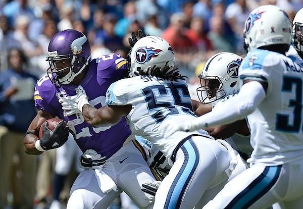 Minnesota Vikings running back Adrian Peterson tries to get past Titans defenders including Sean Spence (55) in the first half last week.