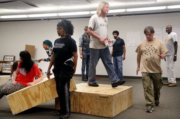 """Richard Brinda, standing on box, is among the cast members in """"Home Street Home Minneapolis,"""" part of the Guthrie's Level Nine Initiative. The s"""