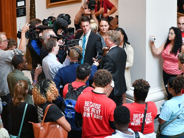 Bruce Nestor, the attorney representing the wage-hike supporters, spoke to reporters after he testified before the state justices.