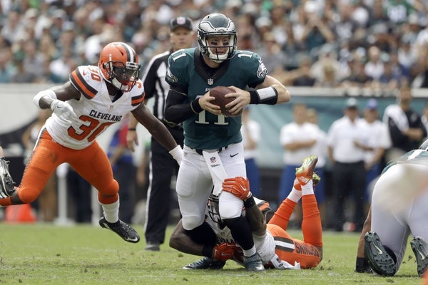 Philadelphia Eagles' Carson Wentz in action during the first half of an NFL football game against the Cleveland Browns, Sunday, Sept. 11, 2016, in Phi