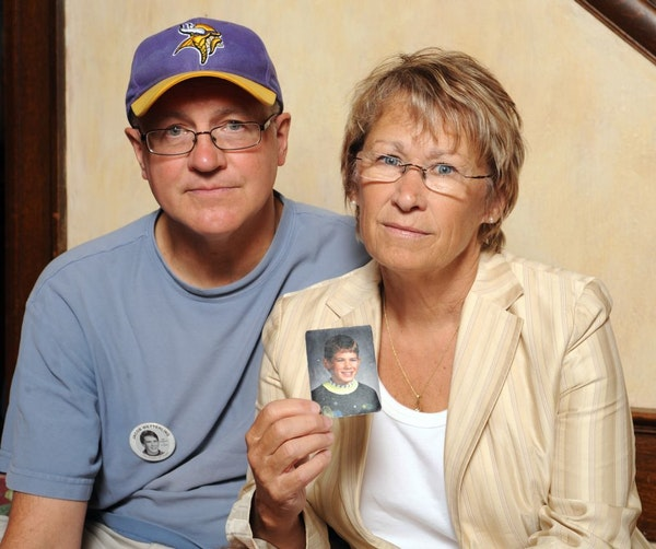 FILE - In this Aug. 28, 2009, file photo, Patty and Jerry Wetterling show a photo of their son Jacob Wetterling, who was abducted in October of 1989 i