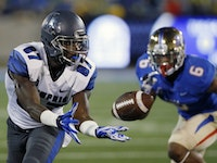 Memphis wide receiver Tevin Jones (87) reaches for a pass in front of Tulsa cornerback Darrell Williams (6) in the first quarter of an NCAA college fo