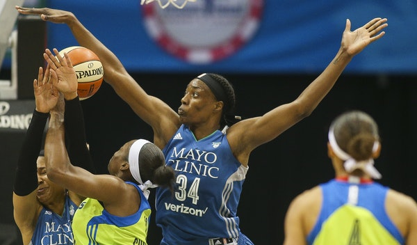 Lynx center Sylvia Fowles blocked a shot by Dallas forward Karima Christmas in midseason. Fowles was named the WNBA's defensive player of the year r