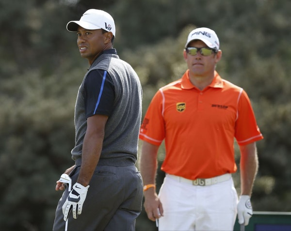 Tiger Woods of the United States, left, and Lee Westwood of England.