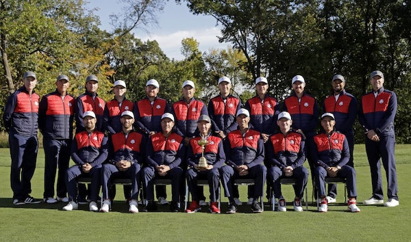 Members of the 2016 United States Ryder Cup team pose for a group photo before a practice round for the Ryder Cup golf tournament Tuesday, Sept. 27, 2