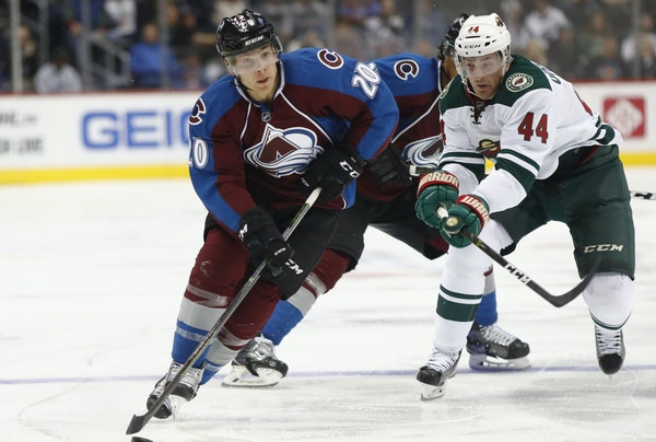 Colorado's Ben Smith, front, looked to pass under pressure from Wild center Tyler Graovac, who's in a battle to make the team.