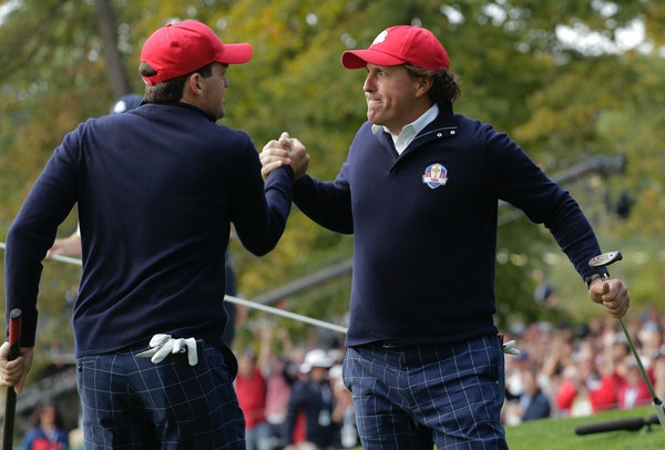 USA's Keegan Bradley congratulates Phil Mickelson during the 2012 Ryder Cup.