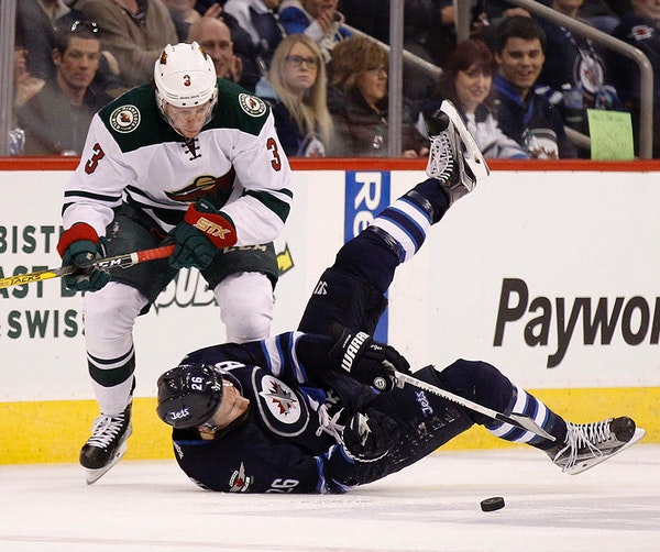 Charlie Coyle, left, took a spot on the right side of Zach Parise's line Wednesday at practice, and it's at right wing where new Wild coach Bruce
