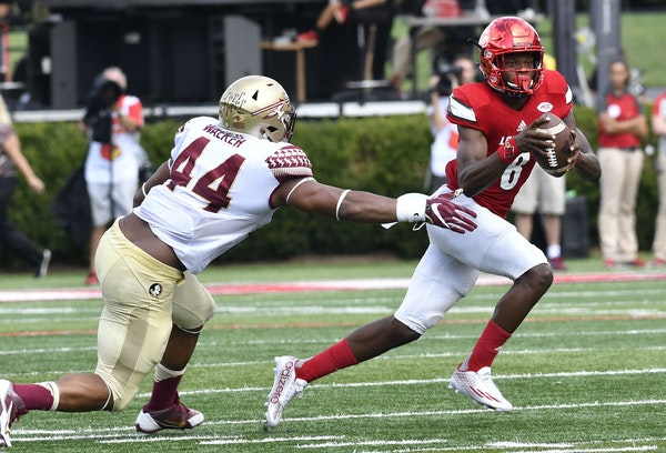 Louisville quarterback Lamar Jackson (8) avoids the tackle form Florida State defensive end DeMarcus Walker (44) during the third quarter of an NCAA c
