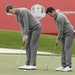 Europe's Rory McIlroy and Thomas Pieters putt on the 18th hole during a practice round for the Ryder Cup golf tournament Wednesday at Hazeltine Nation
