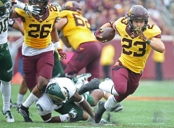 Minnesota's running back Shannon Brooks ran for a first down in the third quarter Saturday against Colorado State