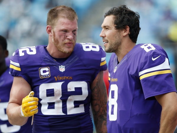 Minnesota Vikings Kyle Rudolph (82) and Sam Bradford (8).