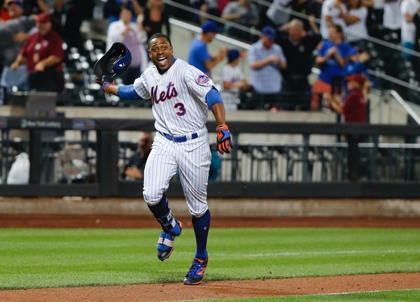 Mets outfielder Curtis Granderson tossed his helmet after his walk-off homer Saturday night, his second homer in as many innings.