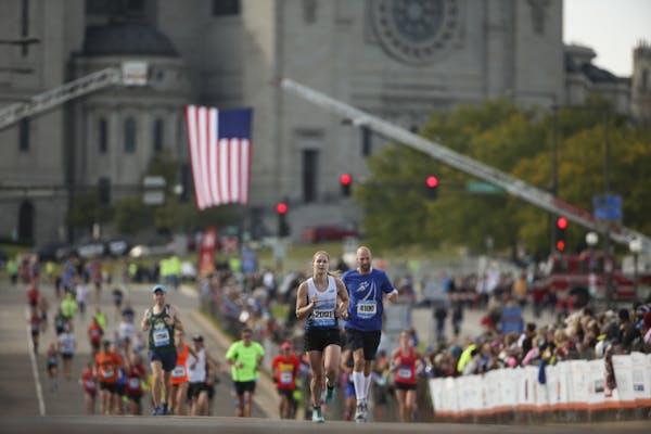 Runners finish the 2015 Twin Cities Marathon.