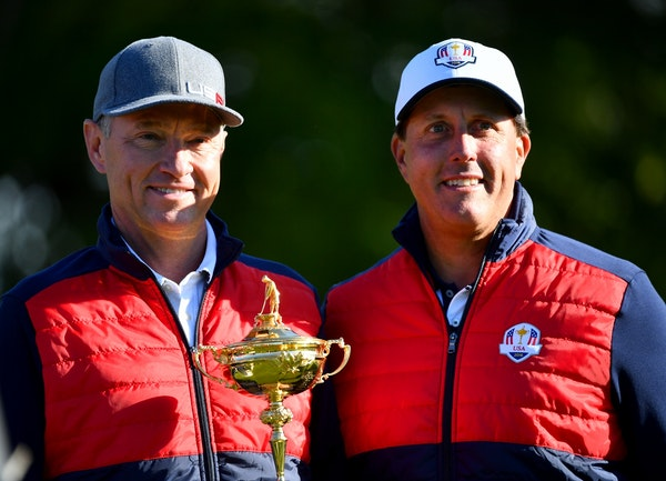 Team USA Captain Davis Love III, left, and Phil Mickelson posed with the Ryder Cup trophy during a team photo session Tuesday morning at Hazeltine Nat