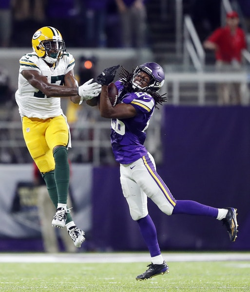 Vikings cornerback Trae Waynes (26) intercepted a pass intended for Green Bay Packers wide receiver Davante Adams (17) late in the fourth quarter Sund