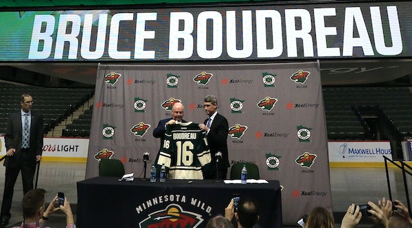 New Minnesota Wild general manager Chuck Fletcher (right) introduced new head coach Bruce Boudreau in May. The team opens training camp Thursday.
