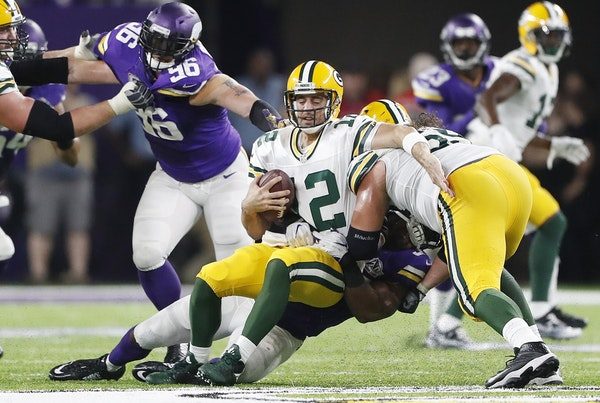 Minnesota Vikings defensive end Everson Griffen (97) sacked Aaron Rogers in the forth quarter at U.S. Bank Stadium Sunday September 18 ,2016 in Minnea