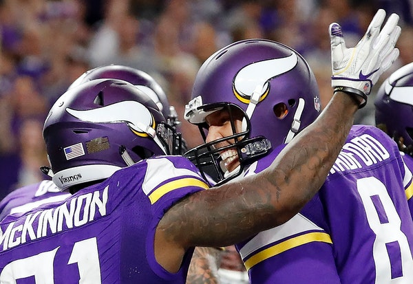 Jerick McKinnon (21) celebrated with Sam Bradford (8) after scoring a 4-yard touchdown in the fourth quarter.