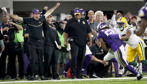 Vikings head coach Mike Zimmer reacted after Trae Waynes (26) intercepted a pass off of Green Bay Packers quarterback Aaron Rodgers in the fourth quar