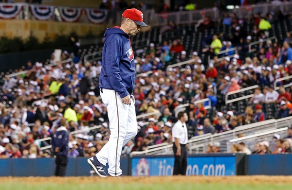 Minnesota Twins manager Paul Molitor walks back to the dugout after one of three pitching changes during the seventh inning of a baseball game against