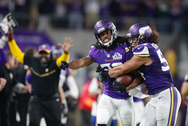 Minnesota Vikings cornerback Trae Waynes (26) celebrated his interception against the Packers late in the forth quarter with linebacker Eric Kendricks