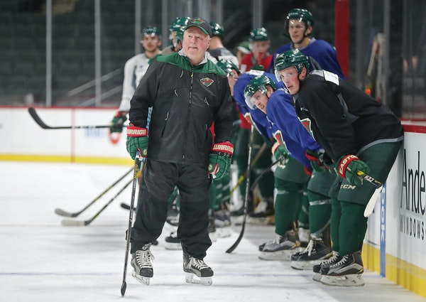Minnesota Wild head coach Bruce Boudreau watched drills from the ice during the first day of practice