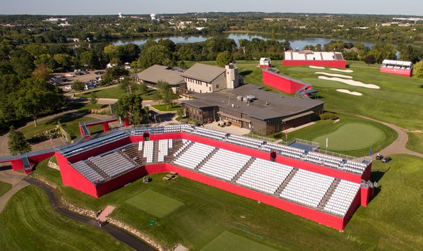 Grandstands tower above the first tee at Hazeltine National, just another reason the best golfers in the world will get nervous before their first dri
