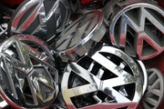 FILE - In this Sept. 23, 2015, file photo Volkswagen ornaments sit in a box in a scrap yard in Berlin, Germany. The Minnesota Pollution Control Agency