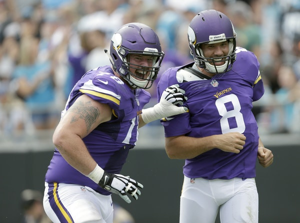 Minnesota Vikings' Jeremiah Sirles (78) celebrates a touchdown with teammate Sam Bradford (8) during the second half of an NFL football game against t