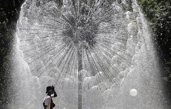 The Berger Fountain, also known as the Dandelion Fountain, in Loring Park glistened in the bright sunlight behind Chyna Porter as she enjoyed an after