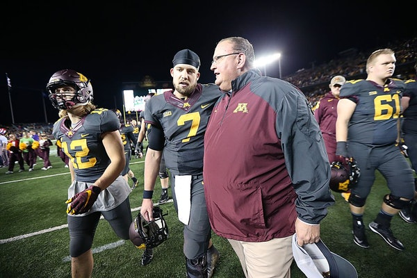 Interim Head Coach Tracy Claeys and Minnesota's quarterback Mitch Leidner walked off the field together after Michigan defeated Minnesota 29-26 at TCF