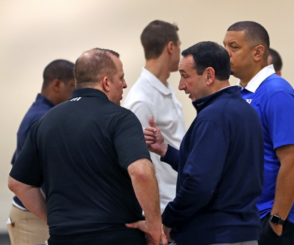 New Wolves coach Tom Thibodeau, left, talked with Duke and Team USA head coach Mike Krzyzewski at Tuesday's practice. Former Wolves coach Randy Wittma