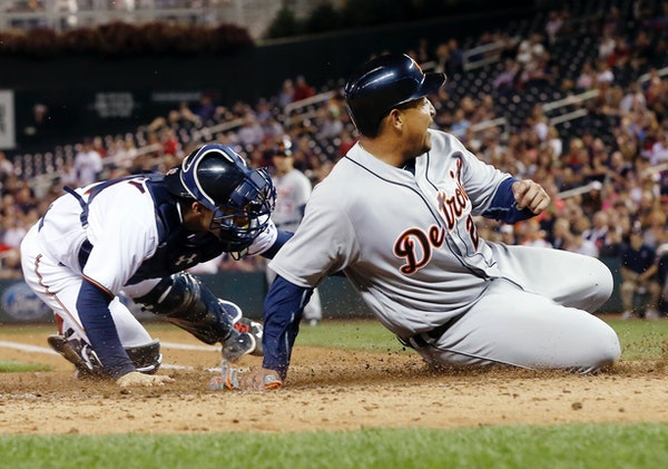Detroit's Miguel Cabrera slid home safely as Twins catcher John Ryan Murphy tried to apply the tag in the fourth inning Tuesday night at Target Field.