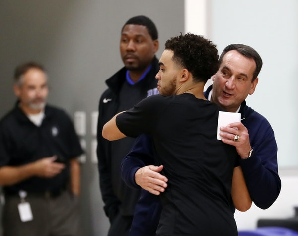 Duke and Team USA head coach Mike Krzyzewski gave a hug to former Duke and Apple Valley star Tyus Jones at Tuesday's Wolves practice.