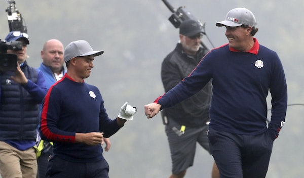 Rickie Fowler and Phil Mickelson fist pump as they come back in their match during the 2016 Ryder Cup, Friday morning Play at Hazeltine National Golf