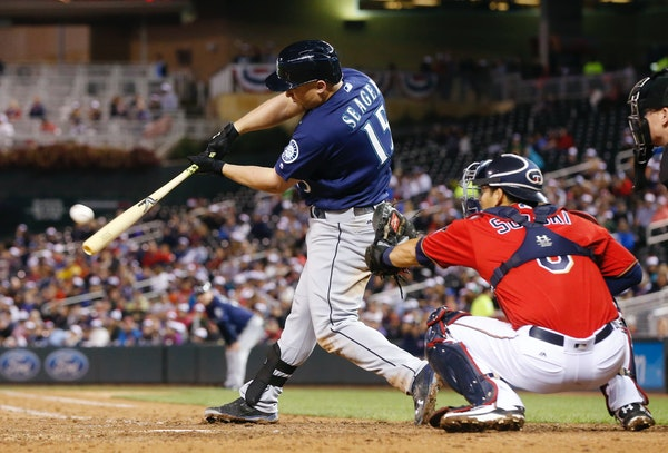 Seattle Mariners' Kyle Seager hits an RBI double off Minnesota Twins pitcher Buddy Boshers during the seventh inning of a baseball game Friday, Sept.