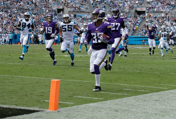 Minnesota Vikings' Marcus Sherels (35) runs for a touchdown against the Carolina Panthers in the first half of an NFL football game in Charlotte, N.C.