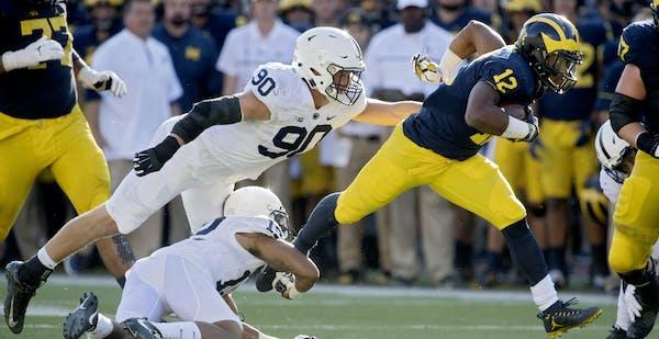 Penn State end Garret Sickles (90) and cornerback Jordan Smith failed badly at stopping Michigan running back Chris Evans.