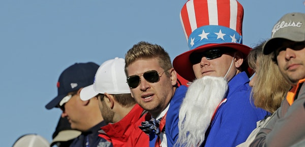 Fans watched from a grandstand above the driving range during a practice round for the Ryder Cup golf tournament Tuesday at Hazeltine National Golf Cl