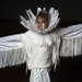 Te'Ariana Jackson,12, is angelic in her outfit with a head dress made with goose feathers.